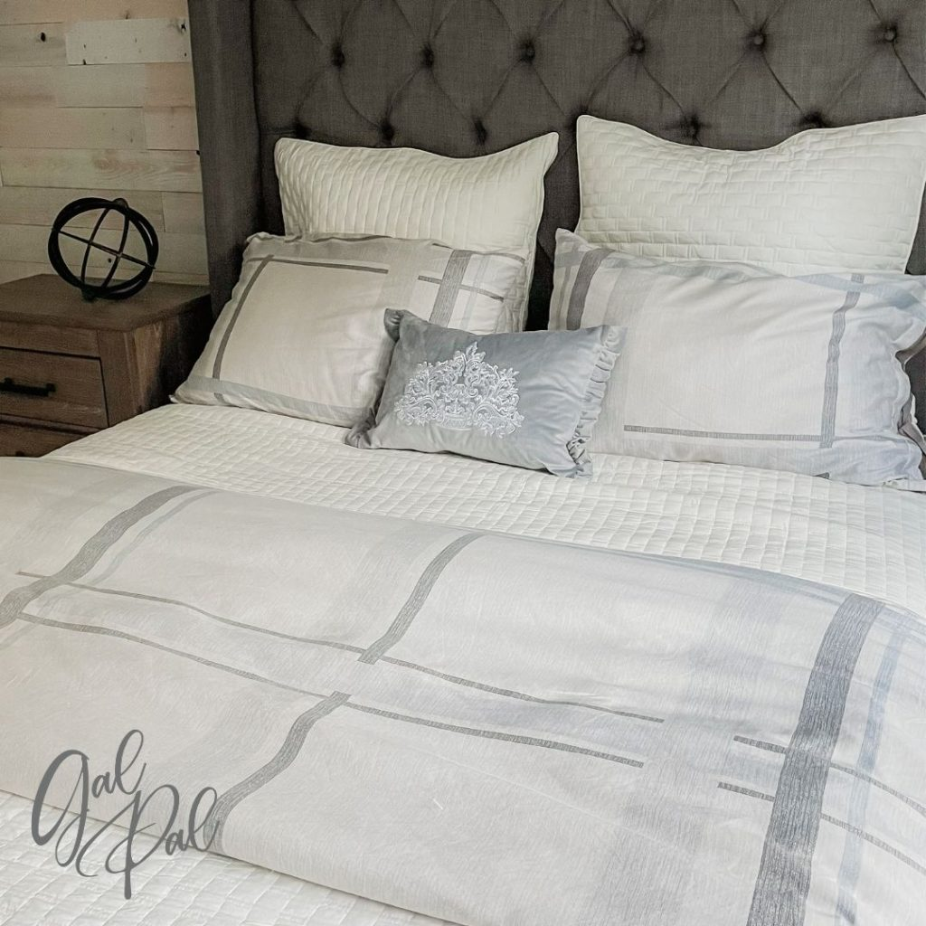 Coverlet across the middle of the bed